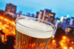 Glass of beer. In the night city stock image