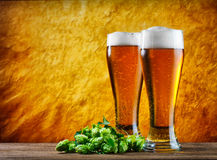 Glass of beer. Beer into glass on a old stone stock image