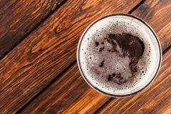 Glass of beer on an old wooden table. top view Royalty Free Stock Images