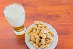 Glass of beer and peanuts royalty free stock images