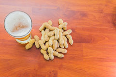 Glass of beer and peanuts Stock Photo