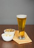 Glass of beer, pistachio and bried squid Stock Photos