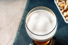 Glass of beer and pistachio nuts Stock Images