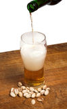 Glass of beer and pistachios Royalty Free Stock Image