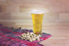 Glass beer and pistachios Royalty Free Stock Image