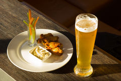 Glass of Beer and Plate of Chicken Wings Royalty Free Stock Photos