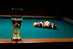 Glass of beer on the pool table Royalty Free Stock Photos