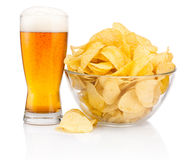 Glass of beer and Potato chips in glass bowl isolated on white Royalty Free Stock Images