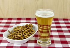 Glass of Beer and Pretzels Royalty Free Stock Image