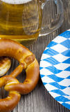 Glass of beer, pretzels and paper plates Stock Image