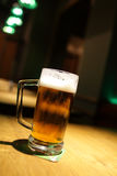 Glass of beer at pub Stock Images