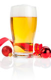 Glass beer,  Red ribbon and Christmas Balls Royalty Free Stock Images
