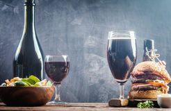 Glass of Beer and red wine. With copy space for text on chalk board background Stock Photos