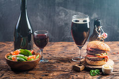 Glass of Beer and red wine. With copy space for text on chalk board background Stock Photography