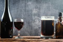 Glass of Beer and red wine. With copy space for text on chalk board background Stock Image