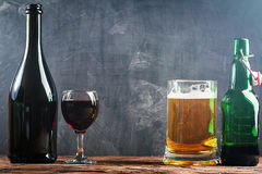 Glass of Beer and red wine. With copy space for text on chalk board background Royalty Free Stock Image