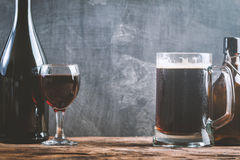 Glass of Beer and red wine. With copy space for text on chalk board background Royalty Free Stock Photography