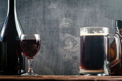 Glass of Beer and red wine. With copy space for text on chalk board background Stock Images