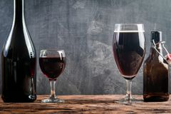Glass of Beer and red wine. With copy space for text on chalk board background Royalty Free Stock Photos