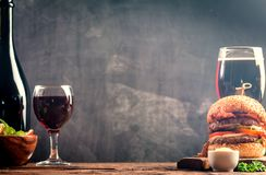 Glass of Beer and red wine. With copy space for text on chalk board background Stock Photo