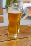 Glass of beer in restaurant on the table Royalty Free Stock Photo