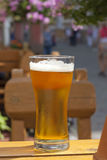 Glass of beer in restaurant on the table Royalty Free Stock Photos
