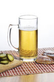 Glass of beer and salty fish. On the wood table Royalty Free Stock Images