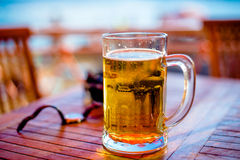 Glass of beer on the sea. Nglass of beer on the beach in Montenegro Royalty Free Stock Photo