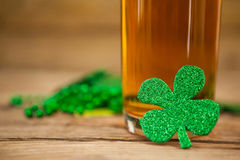 Glass of beer and shamrock for St Patricks Day Stock Image