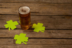 Glass of beer and shamrock for St Patricks Day Royalty Free Stock Image