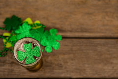 Glass of beer and shamrock for St Patricks Day. On wooden table Stock Photo