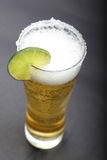Glass of beer with slice of lemon. Stock Photo