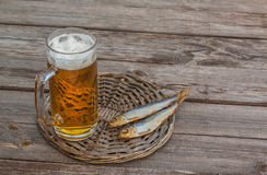 Glass of beer and smoked fish  on a wooden table Stock Photos