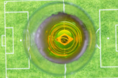 Glass of beer and soccer field. A glass of beer above a soccer field Stock Images
