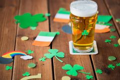 Glass of beer and st patricks day decorations Stock Photography