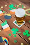 Glass of beer and st patricks day decorations Stock Photos