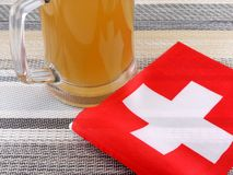 Glass of beer with suisse flag Stock Image