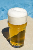 Glass of Beer by the Swimming Pool Royalty Free Stock Photography