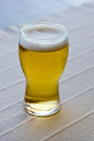 Glass of beer on table Stock Photos