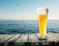 Glass of beer on a table Royalty Free Stock Images