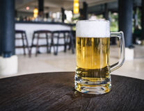 Glass of Beer on table with Blurred Bar counter background Royalty Free Stock Photo