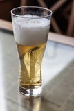 Glass with beer on a table Stock Images