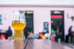 Glass of beer on table edge Stock Image
