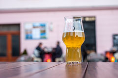 Glass of beer on table edge Royalty Free Stock Photo