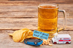 Glass of beer, turned over car, ambulance. Royalty Free Stock Images