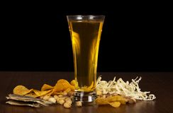 Glass of beer and the various snack Stock Image