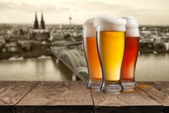 Glass of beer with view of Koeln on background Royalty Free Stock Photo