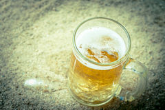 Glass of beer. Vintage retro style and soft focus,Glass of beer on the beach Royalty Free Stock Photography