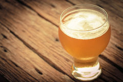 Glass of beer. Vintage retro style and soft focus,Glass of beer on wood table Stock Photography