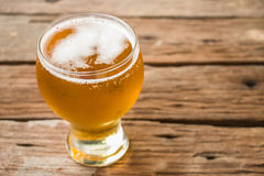 Glass of beer. Vintage retro style and soft focus,Glass of beer on wood table Royalty Free Stock Photos